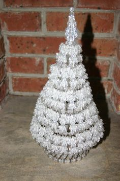 A beaded Christmas tree with safety pins I made as a kid. I recently found the instructions for this craft at http://www.bjcraftsupplies.com/pattern/christmas-beadedSafetyPinTree-crystal01.asp Thinking about making another one this year! It sparkles beautifully with a small light inside!