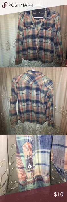 Long sleeve flannel GAP multicolored plaid flannel. Sleeves can be rolled up. Im great conditioned. Only been worn once! GAP Tops Button Down Shirts