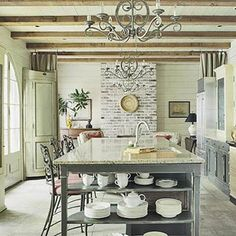 This is a FABULOUS kitchen with neutral tones and modern amenities and yet retains that rustic sought after look