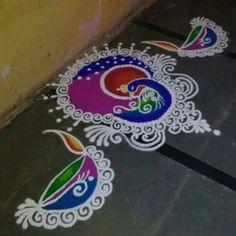 Beautiful and Easy Indian Peacock Rangoli Designs - Indian Fashion Ideas Rangoli Designs Peacock, Rangoli Side Designs, Easy Rangoli Designs Diwali, Rangoli Simple, Rangoli Designs Latest, Simple Rangoli Designs Images, Free Hand Rangoli Design, Rangoli Ideas, Rangoli Designs With Dots