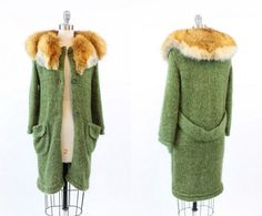 Stunning 1960s oversized cardigan! Made in an ultra cozy forest green knit mohair. Stunning orange fox fur plush collar. Two front bucket pockets.