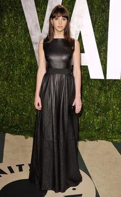 Felicity Jones in an edgy Johanna Johnson leather gown at the Vanity Fair Oscars Party