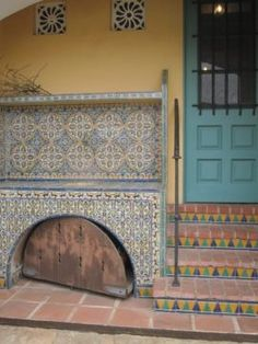 Casa del Herrero - love the yellow and blue with accents of red. Spanish Exterior, Blacksmithing, 1920s, Yellow, Blue, Red, Blacksmith Shop, Blacksmith Forge, Wrought Iron