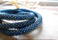 Peacock blue crochet rope necklace with by Calliphorabeads on Etsy