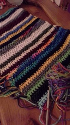 Scrap yarn cowl single crochet stitch. Not quite finished but I like the results so far.