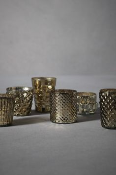 gold votives in various shapes and sizes #holidayentertaining