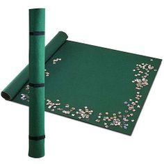 """Portable Jigsaw Roll  Item #43585 - $11.99 - With this unique felt mat system, you can roll up your partially finished jigsaw and all of your sorted pieces around an included hard board tube, attach the Velcro® and elastic bands and file it away until later. Fits puzzles up to 3000 pieces. Mat measures 36"""" x 48""""."""