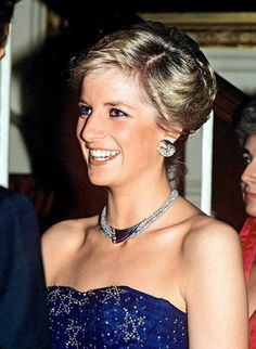 This striking choker and crescent-shaped earrings — part of a set which also included a diamond bracelet — were given to Princess Diana by the Sultan of Oman during the royal couple' s tour of the Gulf States in 1986. Pictured here at a charity performance of Cinderella at the Royal Opera House in 1987, Princess Diana adored the distinctly modern design.