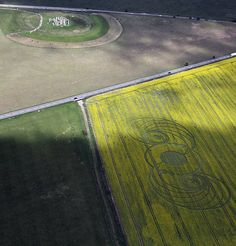 """May 2010 Stonehenge Crop Cricle. This is a football field in length.  Witnesses said it appeared in under an hour, no pictures or video of anyone making it, next to 3 roads.  Yet there it is, flawless in symmetry, and incredibly large scale, that would take """"pranksters with boards"""", even with tools and measurements, weeks to accomplish."""