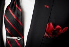 Black suit w/ red buttonholes and vintage tie bar w/ a silk pocket square