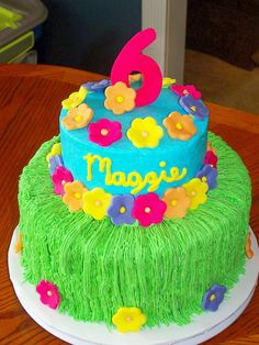 Maggie's Luau This is a 10 in chocolate and 6 inch white cake. Iced in buttercream with fondant flowers. Thanks to lynsey for the...