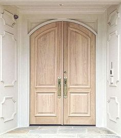 Red Oak with pickling stain and panelling. Double front doors bleached wood look