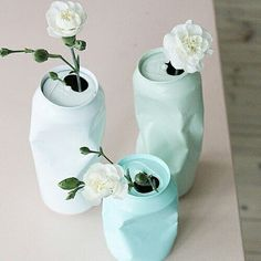 Mint green tin cans become perfect flower pots