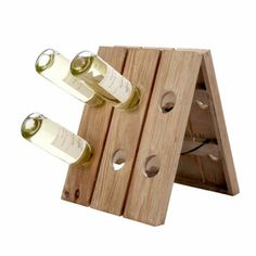 Love the idea of riddling racks, but not their space-hogging size? This fir tabletop version hoists 12 bottles. ($49.95) #50under50  Visit & Like our Facebook page! https://www.facebook.com/pages/Rustic-Farmhouse-Decor/636679889706127
