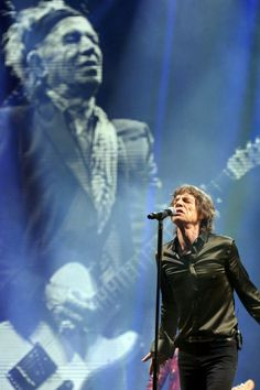 Mick Jagger performs some of the band's most famous hits on stage at Glastonbury.
