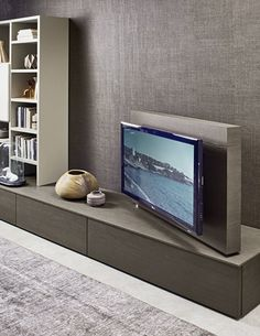The Kronos features a swivel TV stand, allowing you to view your TV from the perfect angle. Available from IQ Furniture. Tv Furniture, Living Room Furniture, Tv Stand Room Divider, Corner Tv Unit, Swivel Tv Stand, Rack Tv, Muebles Living, Tv Unit Design, Diy Tv Stand