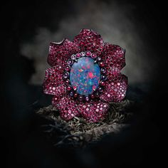 Chopard Fleurs d'Opales ring in 18ct rose and white gold, titanium and zirconium, set with multi-coloured sapphires, rubies, garnets and black diamonds surrounding a centrally set 9ct black opal
