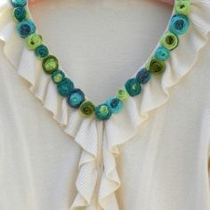 Carolyn of Homework shares a great idea for updating a tired sweater. She uses novelty yarn to create colorful rolled roses to embellish the neckline. While her post isn't a tutorial, she inc… Sewing Hacks, Sewing Tutorials, Sewing Crafts, Sewing Projects, Diy Projects, Sewing Tools, Sewing Ideas, Yarn Flowers, Rose Tutorial