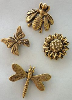 Decorative Sun Flower, Dragonfly, Butterfly, & Bumble Bee Push Pins  Made in USA of lead free metal.  Has a nail on back to push into soft wood or bulletin board!