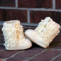 crochet baby booties pattern by  TwoGirlsPatterns. Adore those yarny loops!