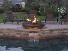 We think this #GrandEffects Cielo #FirePit sunk into a stone pool edge is absolutely stunning! Do you agree? #MidAmericaSales http://qoo.ly/gs47n