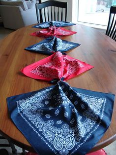 Tied Bandana Table Runner — Here's another unique table runner originally from www.MattAndShari.com. This Tied Bandana Table Runner is made by tying bandanas at the corners with twine or ribbon. That sure wouldn't take long! #bandana #partyideas #tablerunner
