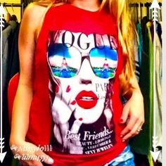 Red Vogue Muscle Tee FINAL NWT red graphic tee! Vogue cover girl with Paris' Eiffel Tower reflecting from her shades. The red lips and girly girl feel with a touch of tomboy is absolutely perfect!! Great with jeans, leggings, or highrise cutoff shorts. No trades, 3 items for 20% off, Shop our children's closet @lilmissys for tot-tween fashion. Bundle discounts apply. Two closets, one shipping fee. Please comment and I will create a new listing. On Fire Tops Muscle Tees