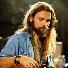 Chris Traynor....a man and his guitar...*YUM* love the long hair....he plays awesome too of course