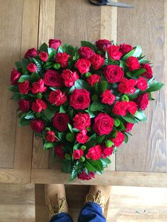 "18"" fresh flower heart for a funeral. Red velvet roses and carnations. #roberthallfloristryhome #rhfh #roberthall #flowerheart #redroses #freshflowers"