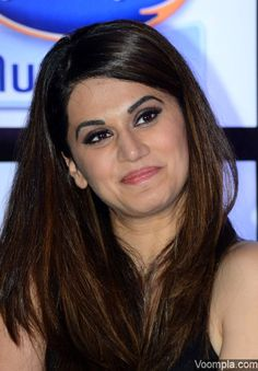 Taapsee Pannu's hairstyle - straight with side parting and brown highlights. via Voompla.com