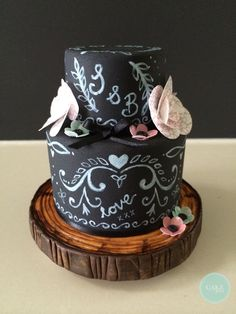 Miniature wedding cake stands 10cm tall with blackboard effect on icing and a handmade wooden look stand