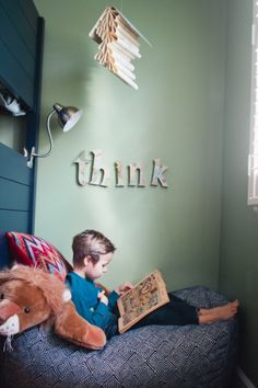 "*Love* this reading corner with the book ""mobile"" and letters on the wall"