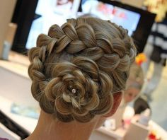 I chose this image because, I liked how the braid came into like a rise shaped form. This hair do would be really nice for elegant parties and occasions.