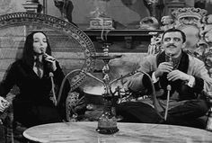 The Addams Family Gomez and Morticia Addams Smoking Hookah- this is awesome ^-^ Addams Family Morticia, Los Addams, The Addams Family 1964, Morticia And Gomez Addams, Addams Family Tv Show, Adam Meme, John Astin, Charles Addams, Carolyn Jones