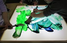 Gross motor painting- big house painting brushes and big arm movements painting on the light table
