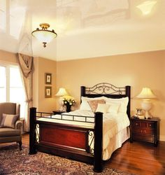 Beige lacquer stretch ceiling in a bedroom.