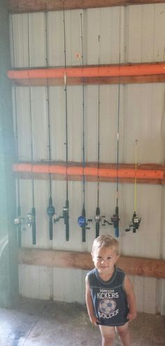Fishing pole rack knotty pine work pics stuff i for Ice fishing noodle rod