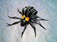 Spooky Spider Hair Bow, Spider Ribbon Sculpture, Halloween Bow, Grosgrain Ribbon on Alligator Clip for Girls, Baby Girl by ScrapManiacShop on Etsy https://www.etsy.com/listing/202007222/spooky-spider-hair-bow-spider-ribbon