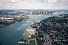 he Detroit River - This view is looking north and was taken from the Windsor, Canada side. That's the Ambassador Bridge and downtown Detroit.