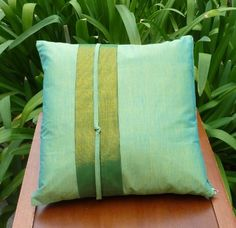 Bali Pillow cover - Green iridescent with green-gold songket strip  Price : $13.00 http://balipillowsplus.hostedbywebstore.com/Bali-Pillow-cover-iridescent-green-gold/dp/B00E6YO6CO