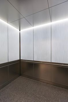 LEVELe Elevator Interior with LightPlane Panels in VIviGraphix Graphica glass with Cairo interlayer and Pearlex finish; Capture panels in Stainless Steel with Sandstone finish; Round handrail at Private Location, New York, New York