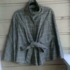 The Sherlock Holmes cape. What else can I say? It look exactly like Mr. Holmes famous attire.   However, you will feel very sexy in yours.  Pairs well with jeans for the more casual outings.  I wore it well with some cute leggings and riding boots. New York & Company Jackets & Coats Capes