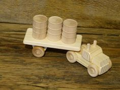 Handmade original design wood toy ice road truck. 7 inches long and 1 3/4 inches wide, wheels all turn and cab and trailer detach. Made from pine,