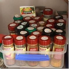 Spice storage with stickers on top showing what they are- not necessarily the cutest but certainly practical