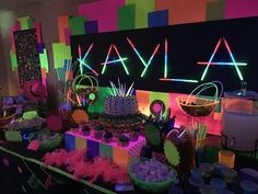 Created this dessert/candy buffet and decor for my daughter Kayla's 11th birthday..Glow in the dark party by Melita