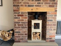 Chesney's Shoreditch 4 XLS in parchment, installed in a brick fireplace with beam. Brick Fireplace, Stoves, Wood Burning, Beams, Home Decor, Ovens, Brick Fire Pits, Interior Design, Home Interior Design