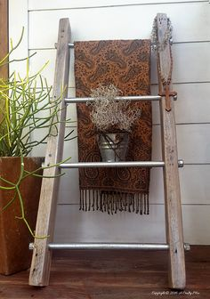 A throw and a little plant make a lovely statement on this easy to make industrial chic storage ladder