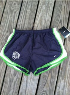 so cute- the bride and bridesmaid wear monogrammed running shorts in the wedding colors and white button downs to get ready- adorable pictures!
