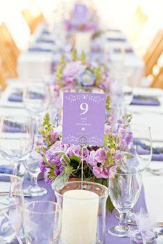 Lavender low centerpiece and table number love. Fleurish Floral Designs. Photography by mirellecarmichael.com/