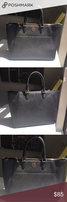 DKNY Large Saffiano Leather in Black It is so clean and nice. It is suitable for everyday use. You can match with your clothes easily. I think every women should have this kind of black bag. Thanks. Dkny Bags Totes